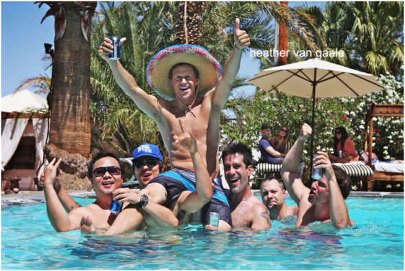 groomsmen party in pool at destination wedding palm springs