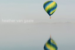 hot air balloon over lake skinner with reflection by heather van gale