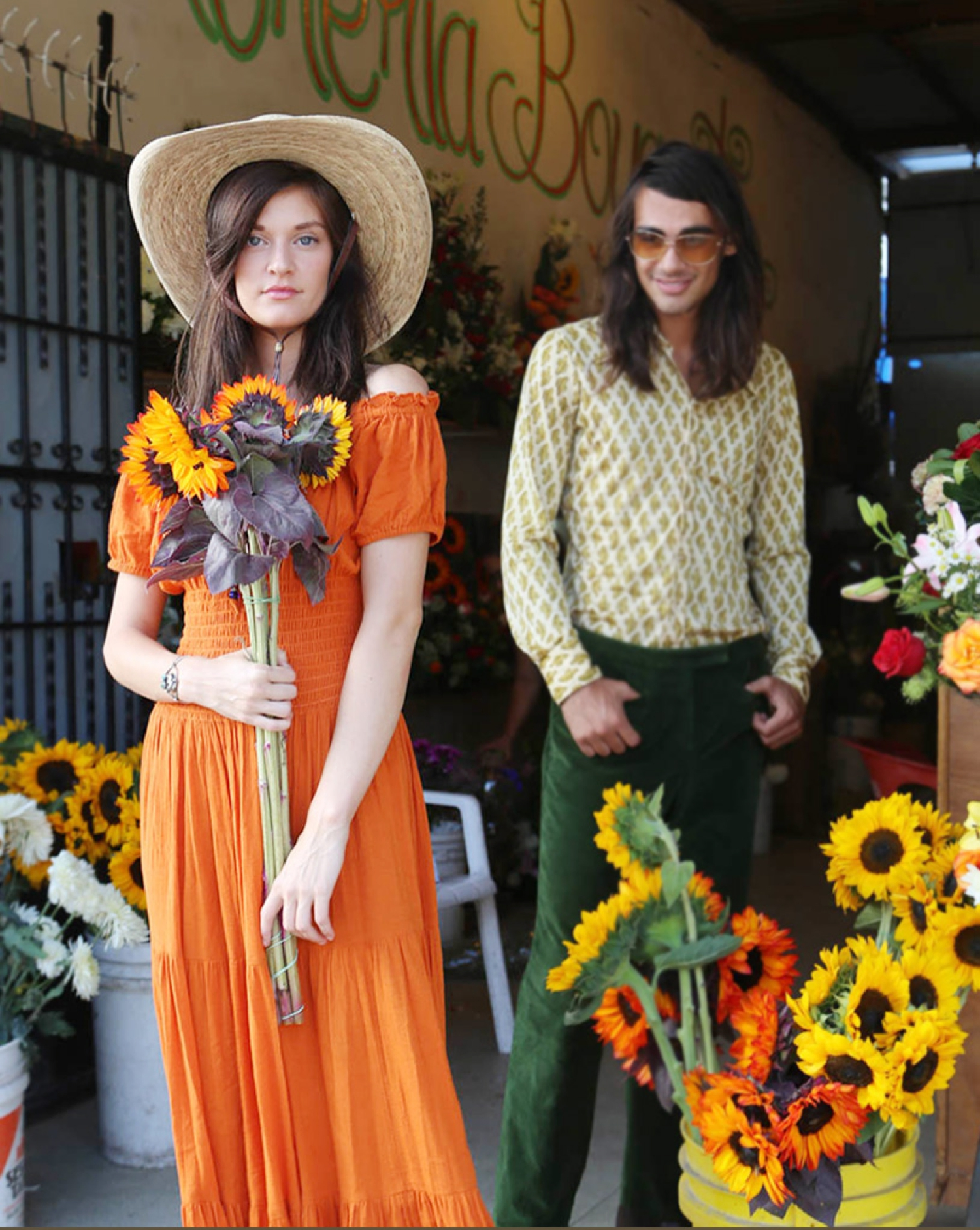 couple fashion editorial with sunflowers and retro fall fashion in mexico baja california